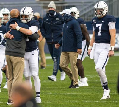Football vs Iowa, Sean Clifford (14) and James Franklin embrace