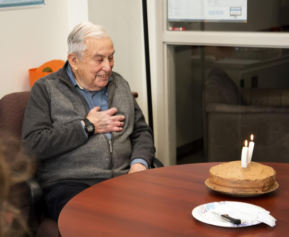 Professor Ted Fuller with birthday cake