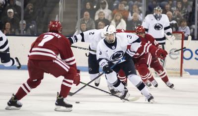 Men's Hockey vs. Wisconsin, Denaples (3) Defends
