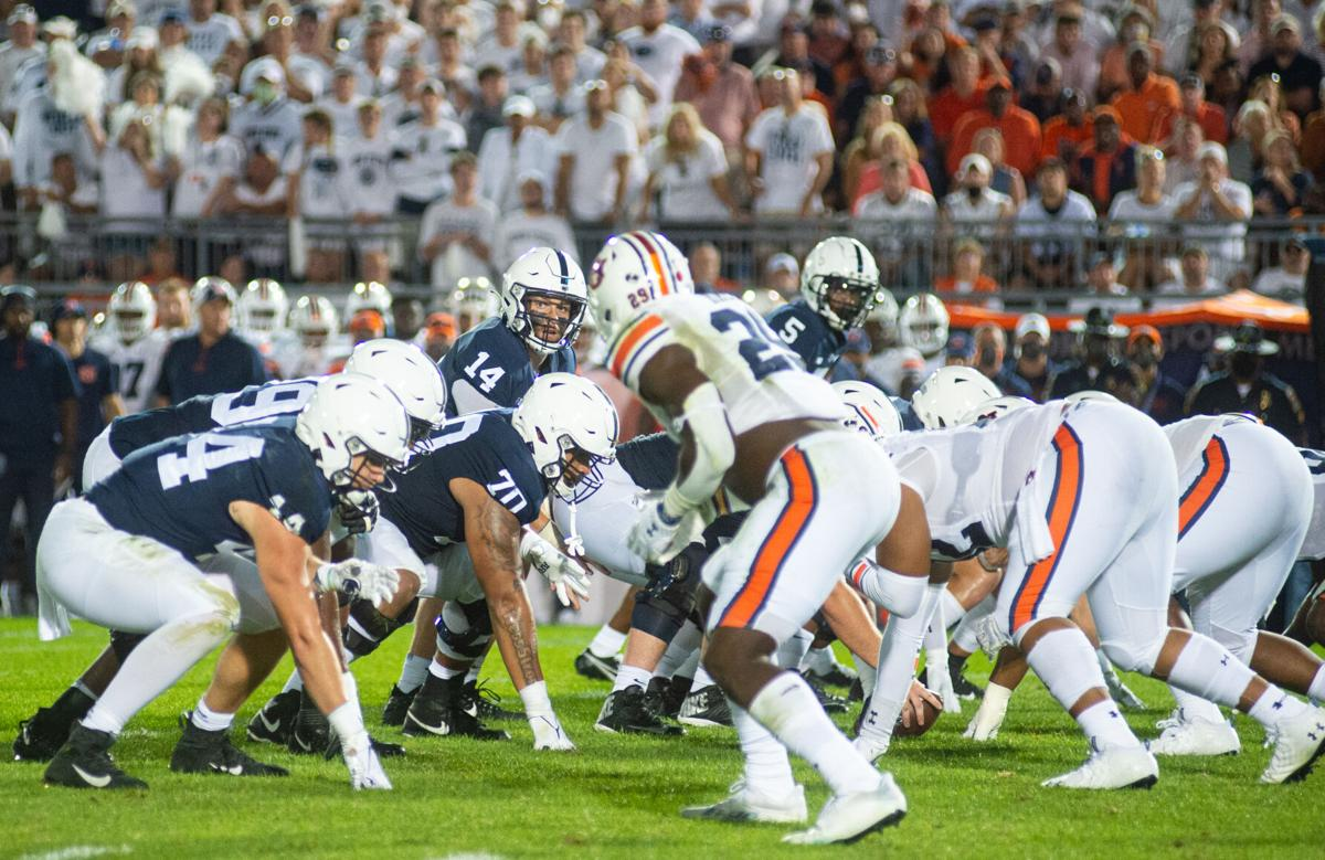 Football players get set for a play during the White Out