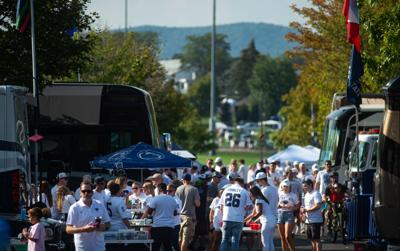 Tailgaters party outside their RVs