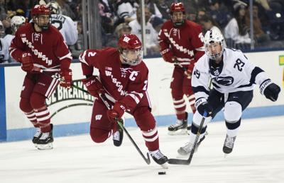 Men's Hockey vs. Wisconsin, Maceachern (29) Chases the Puck