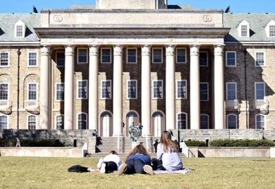 Students gather on Old Main Lawn to enjoy warm weather