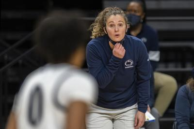 Coach Carolyn Kieger talks to Nyam Thorton