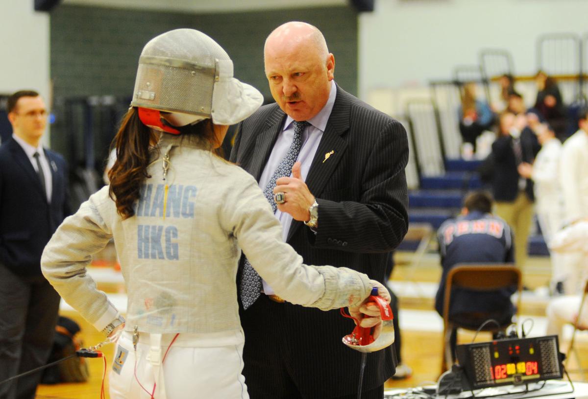 Head coach Wieslaw 'Wes' Glon talk to Karen Chang (saber)