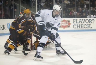 Men's Hockey vs. Minnesota, Berger (8)