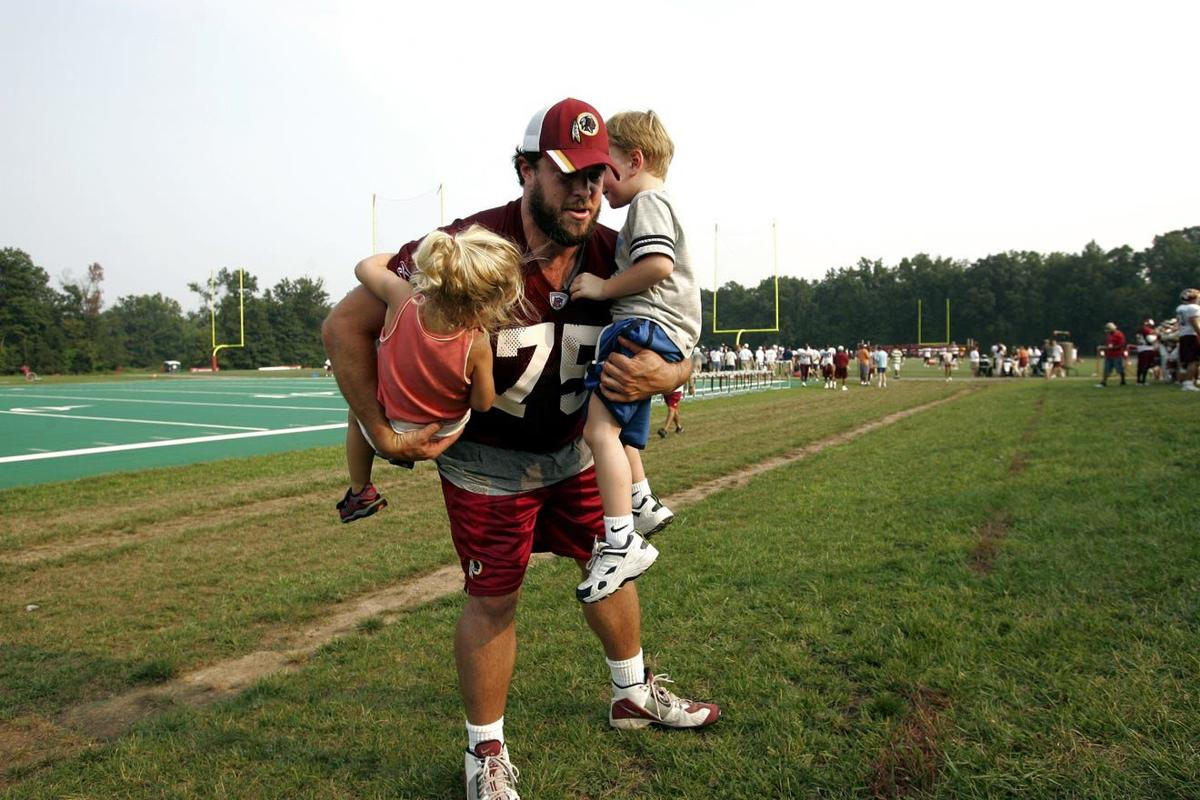 Brandon Noble with Kids AP Photo