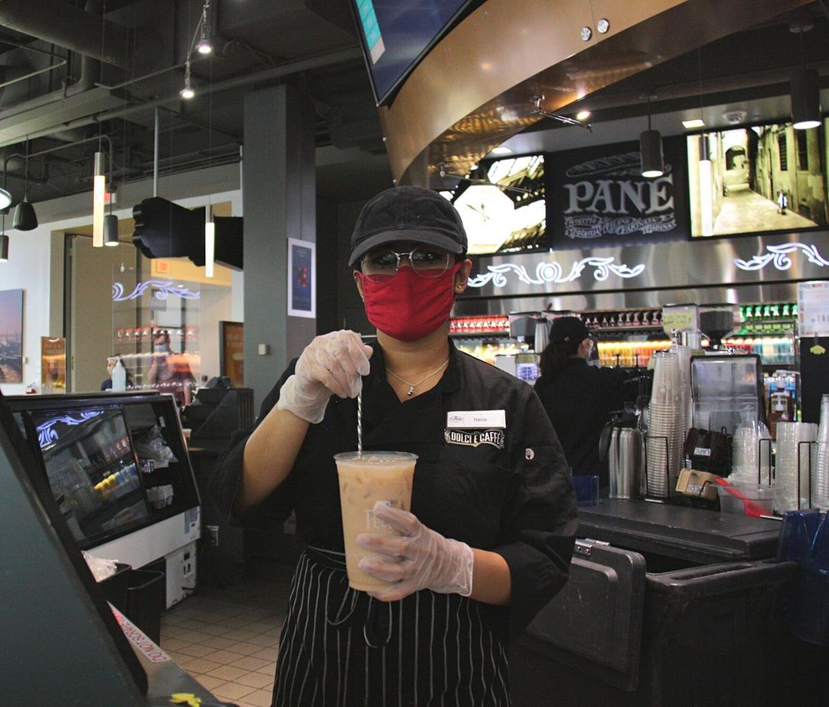 Dolci E Caffe Employee w/ coffee