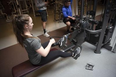 Student working out in McComas Gym