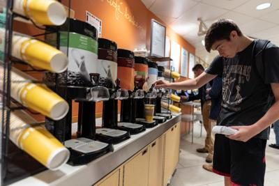 Student pouring coffee