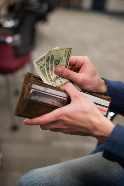 Student Taking Money out of wallet