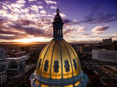 Aerial/Drone view.  Sunset over the Capitol building of Denver, Colorado