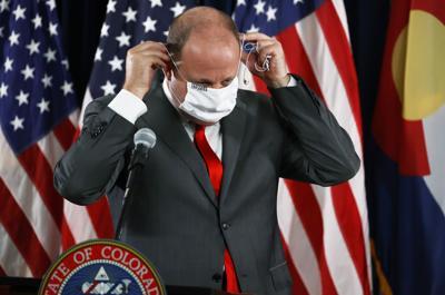 States resist mask rules as Midwest virus uptick stirs alarm