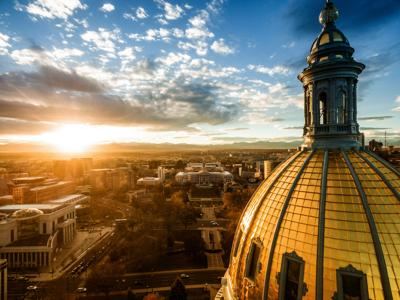 The Colorado state Capitol at sunset as seen from a drone.