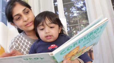 Mom__child_reading_corduroy_doctor-900x0-c-default.png