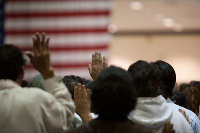 Immigrants at a swearing in ceremony