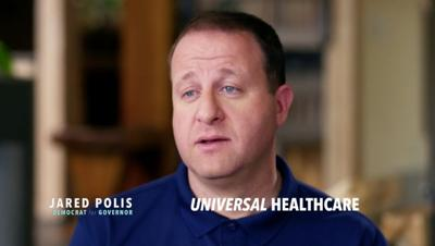 Polis comes out strong for universal health care in ad