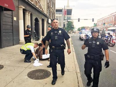 WATCH: Police video shows detention of Denver journalist