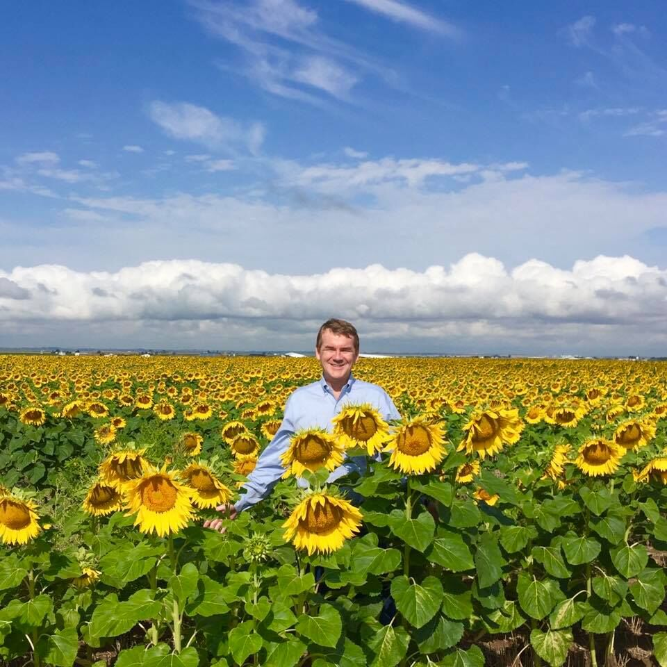 Michael Bennet and sunflowers.jpg