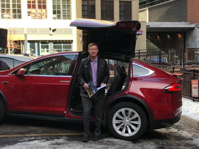 Gov. John Hickenlooper checks out an electric vehicle in January 2018 before announcing a statewide plan to encourage more charging stations.