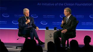 Big Dog leaves mark at Clinton Global summit in Denver