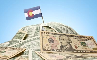 Flag of Colorado sticking in american banknotes.(series)