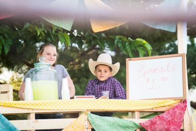 Rodeo event, Children serving homemade lemonade at a stall.