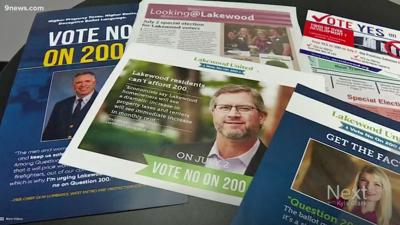 Flyers for and against Lakewood's Question 200. (KUSA-9News)