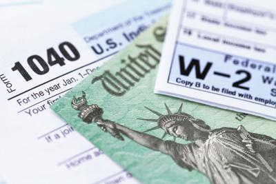 IRS tax forms with tax refund check taxes tabor