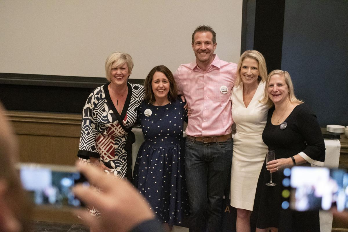 Denver mayoral candidate Jamie Giellis, second from right, poses with her husband Chris Giellis