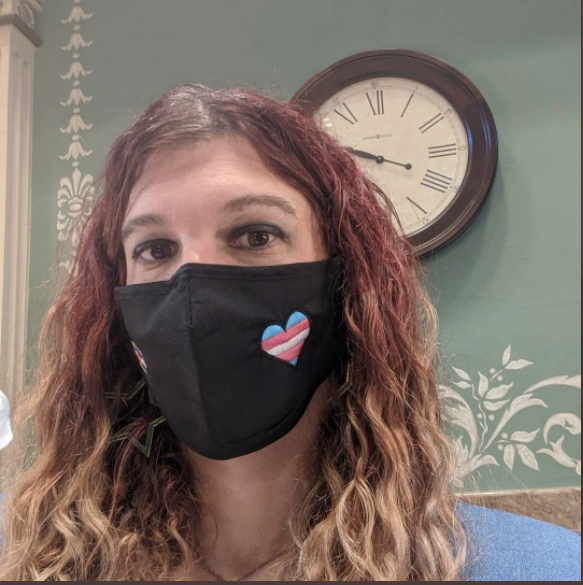 Rep. Brianna Titone, wearing a mask with the trans flag colors, March 31, 2021