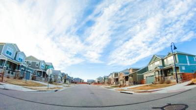 Driving through new residential neighborhood in suburbia