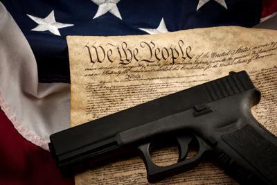 American constitution, USA flag and a handgun