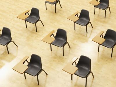 Desks in empty classroom