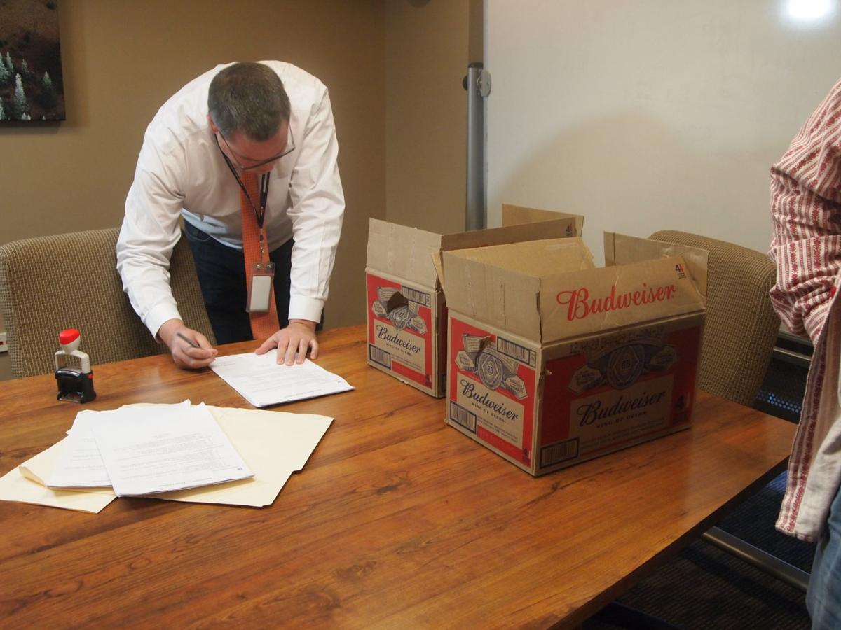 SOS staff looking over petitions