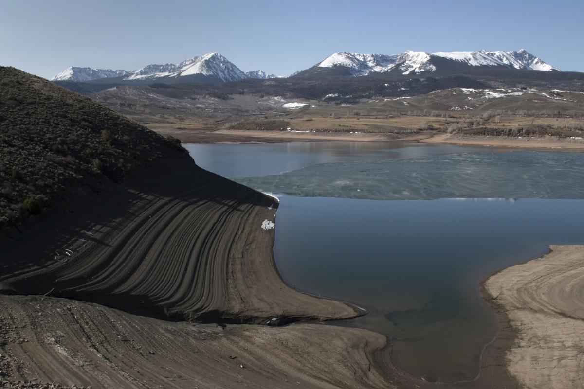 Low water in Colorado Rocky Mountain reservoir during drought