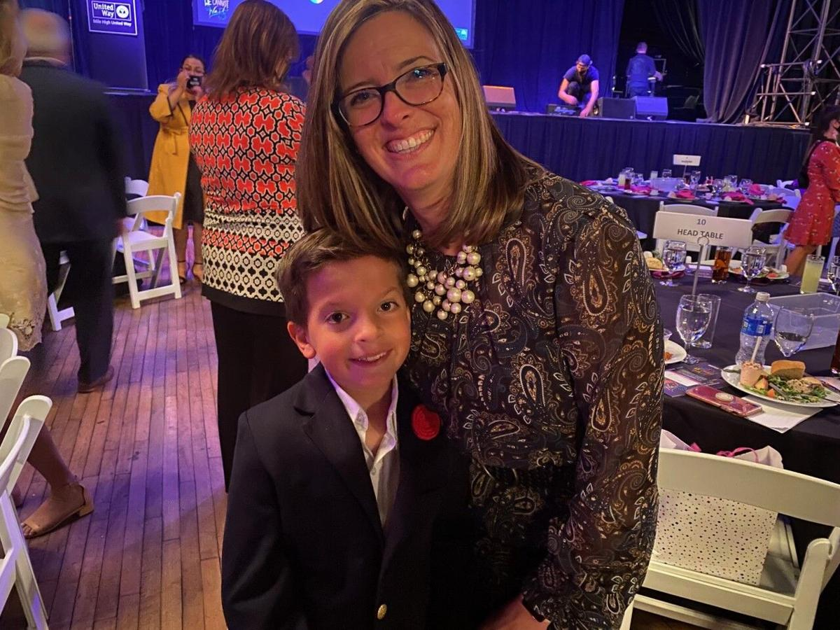 Luncheon co-chair Alice Jackson with her son, Luke.