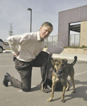 Two bill signings mark dog day at the Legislature