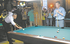 A slice of pizza, a sip of beer, a game of pool...