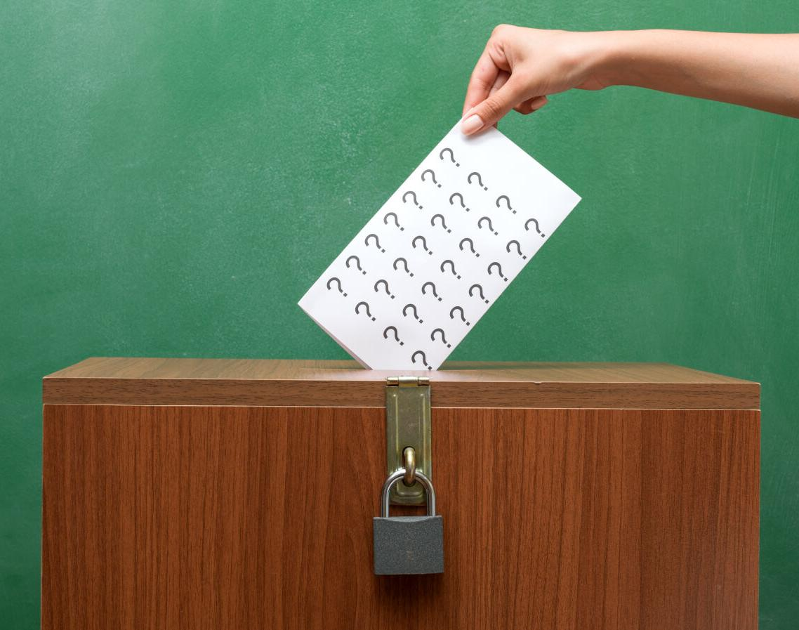 Voting for election,ballot box in front of blackboard