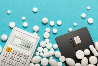 Credit card and medicines (pills). High cost of treatment in hospital, expensive medications concept
