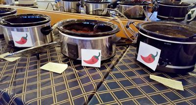row of crock pots for chili cook off contest