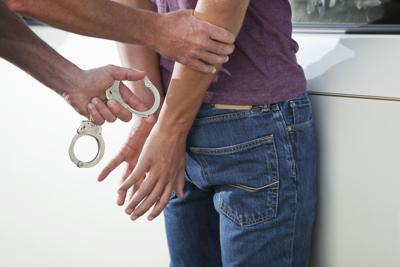Teenager being handcuffed
