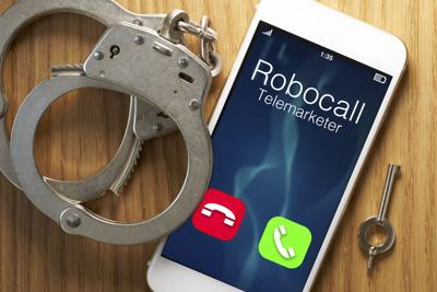 Telemarketer robocall scam: legislation for smartphone with gavel