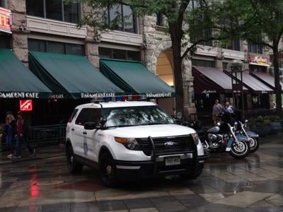 Denver Police SUV and Motorcycles park on promenade