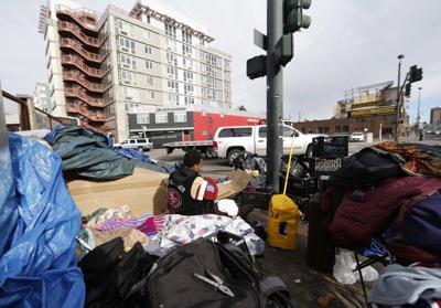 COVER STORY Denver homeless campaign ban 300 trash
