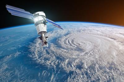 Research, probing, monitoring hurricane Florence raging on the coast. Satellite above the Earth makes measurements of the weather parameters. Elements of this image furnished by NASA.