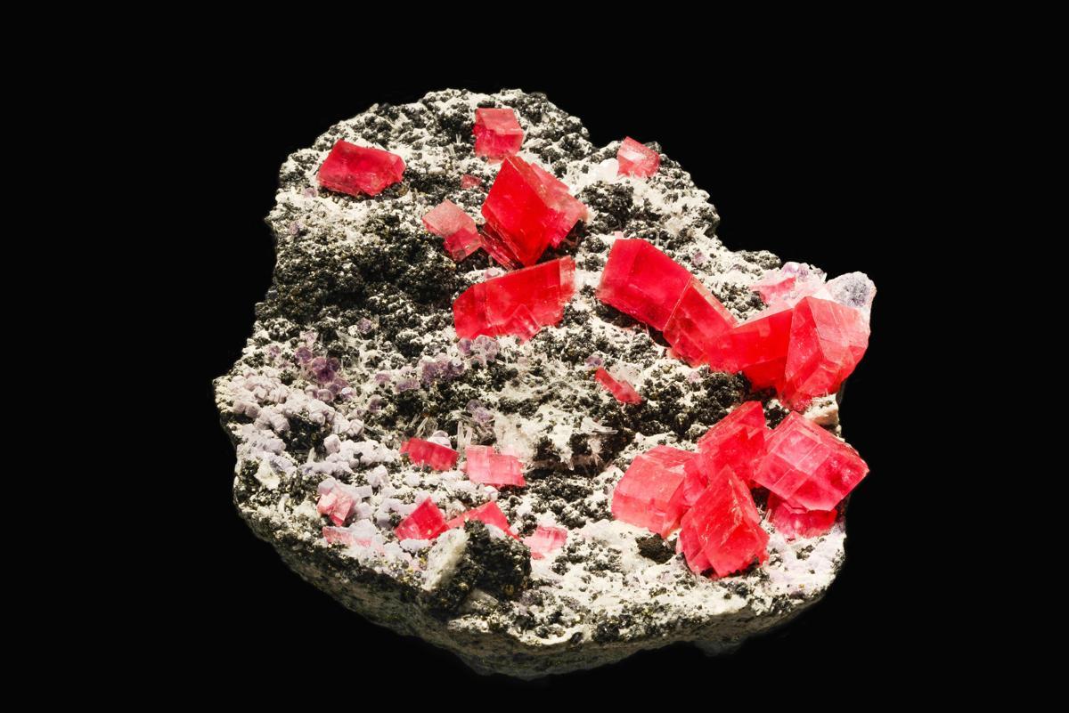 Bright Red Rhodochrosite Mineral against Black Background