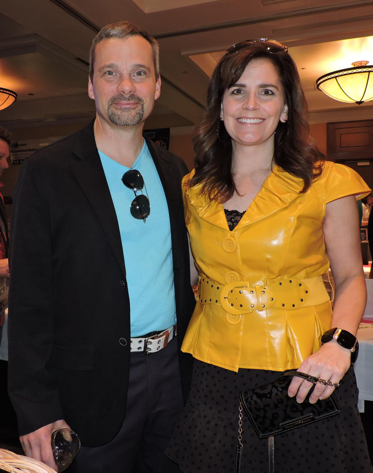 "Tri-Lakes Chamber annual awards: Matt and Jamie Glover in ""Miami Vice"" colors 040718 Photo by Linda Navarro"