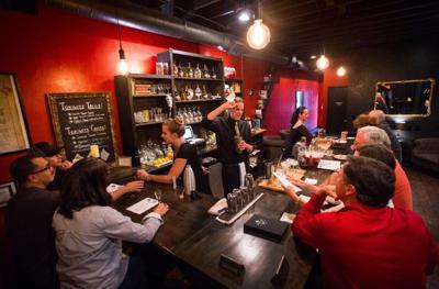 Bartenders Eliza Lovett, left, Nate Windham and Erika Mullett serve gin cocktails Thursday, Aug. 25, 2016, at Brooklyn's on Boulder. The speakeasy is open Thursday through Sunday. (The Gazette, Christian Murdock)